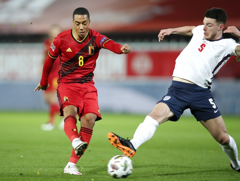 Belgium's Youri Tielemans, left, kicks the ball past England's Declan Rice to score his team's first goal during the UEFA Nations League soccer match ...
