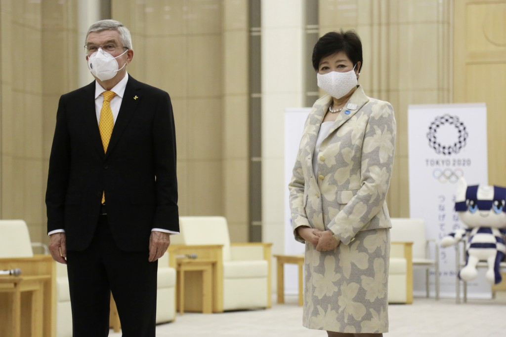 International Olympic Committee President Thomas Bach, left, and Tokyo Governor Yuriko Koike, right, pose for a photo, before their meeting in Tokyo, ...