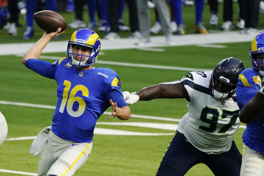 Los Angeles Rams quarterback Jared Goff (16) throws under pressure from Seattle Seahawks defensive tackle Poona Ford (97) during the first half of an ...