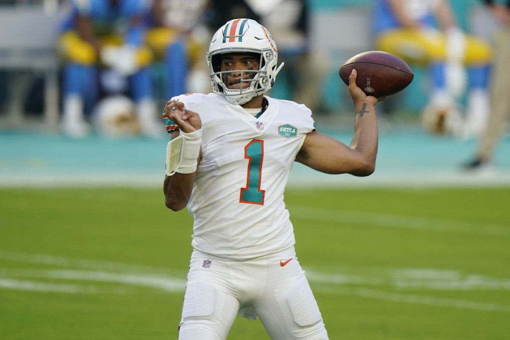 Miami Dolphins quarterback Tua Tagovailoa (1) looks to pass the football during the first half of an NFL football game against the Los Angeles Charger...