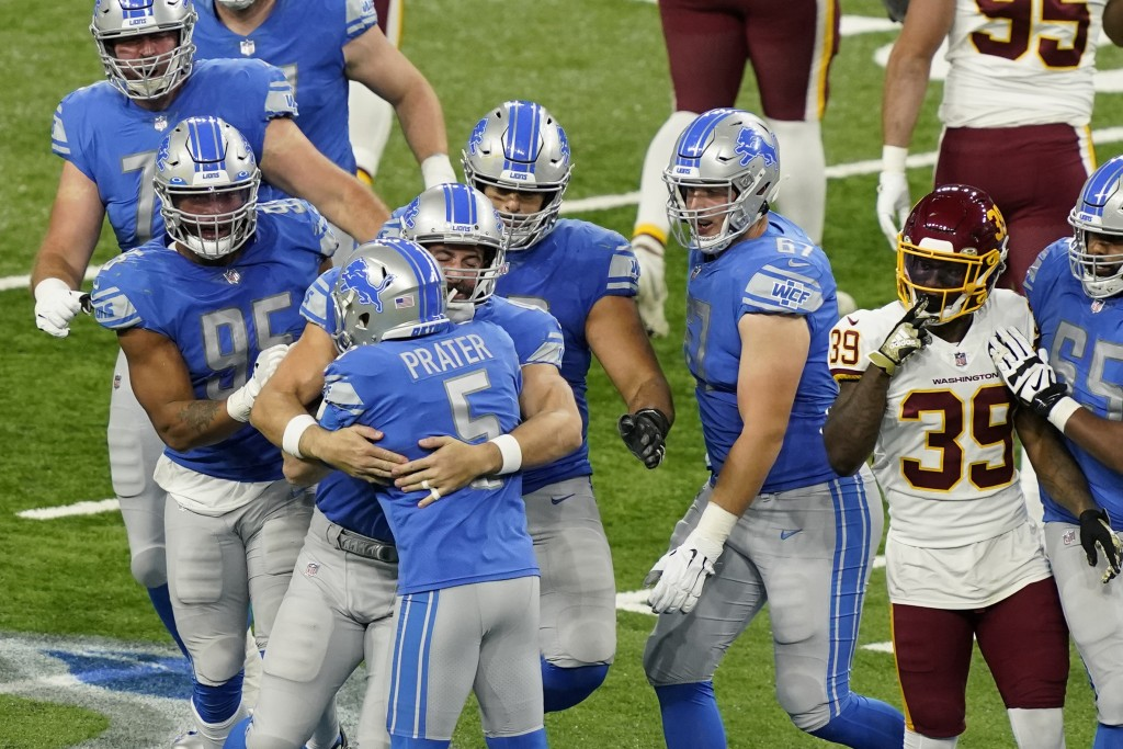 Teammates hug Detroit Lions kicker Matt Prater (5) after his winning field goal in the closing seconds during the second half of an NFL football game ...