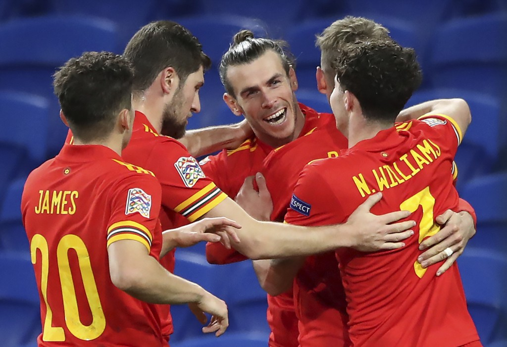 Wales' Gareth Bale, center, and teammates celebrate their first goal scored by David Brooks, 2nd right, during the UEFA Nations League soccer match at...