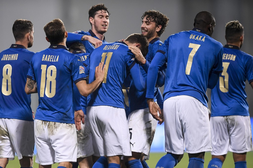 Italy's players celebrate after their teammate Domenico Berardi, center (11) scored the winning goal during the UEFA Nations League soccer match betwe...