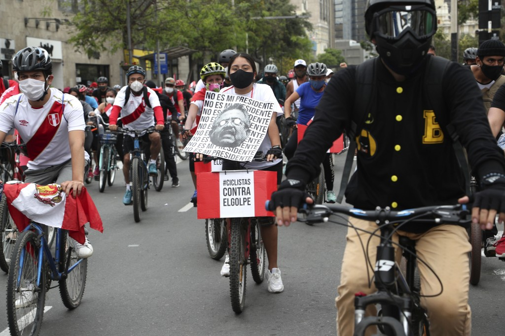 Hundred of bikers ride on the street against the removal of President Martin Vizcarra, in Lima's Miraflores district, Peru, Sunday, Nov. 15, 2020. Pre...