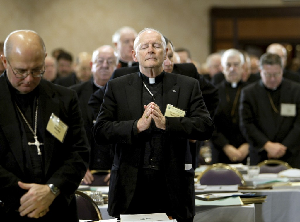 FILE - In this Nov. 10, 2003 file photo, Cardinal Theodore Edgar McCarrick, Archbishop of Washington, D.C., center, joins fellow clergy in prayer at t...