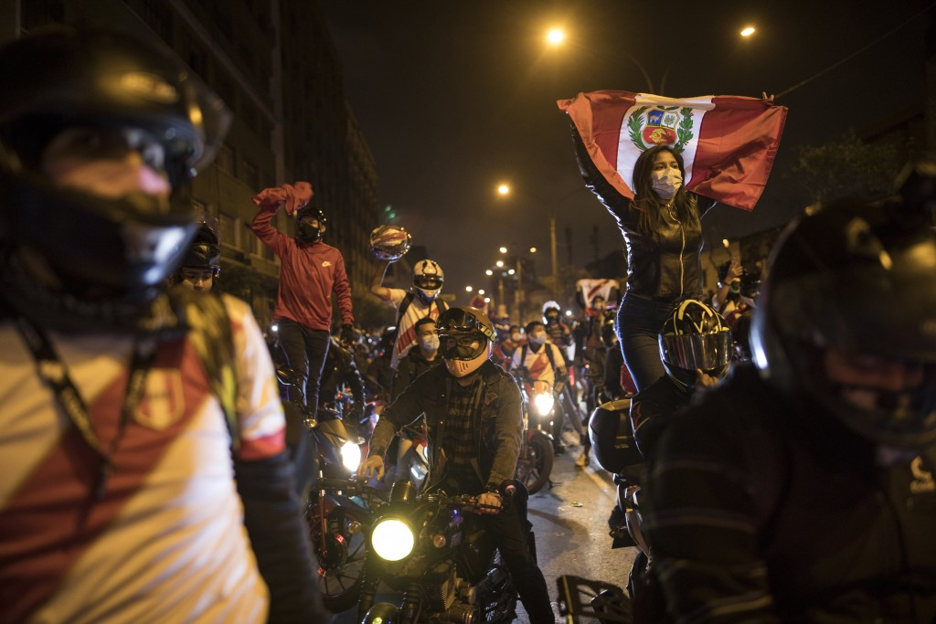A caravan of demonstrators on motorcycles ride as they wait for news on who will be the country's next president, in Lima, Peru, Sunday, Nov. 15, 2020...