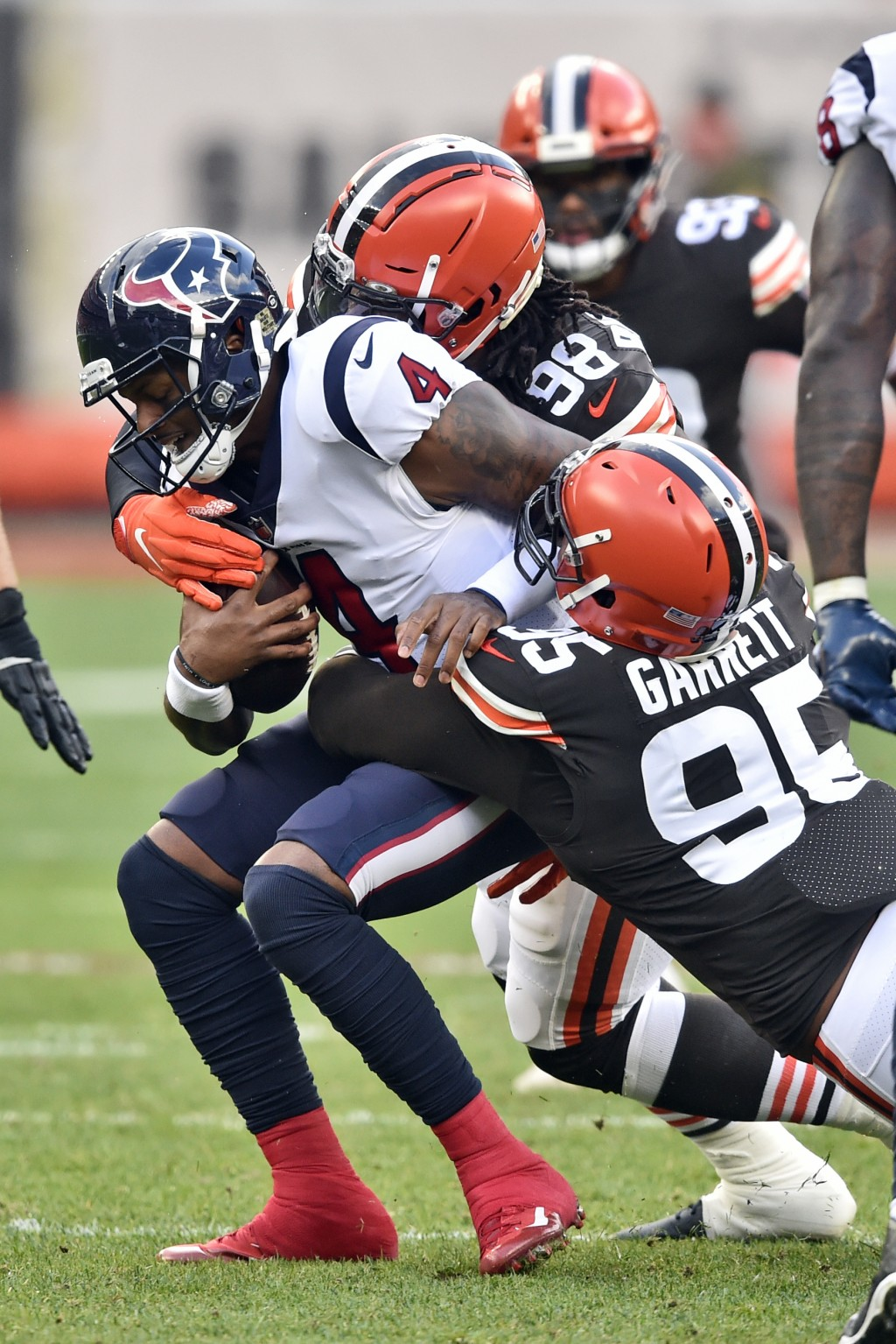 Cleveland Browns defensive end Myles Garrett (95) sacks Houston Texans quarterback Deshaun Watson (4) during the first half of an NFL football game, S...