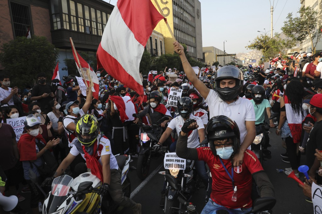A caravan of demonstrators on motorcycles ride after interim President Manuel Merino resigned his post, in Lima, Peru, Sunday, Nov. 15, 2020. Merino a...