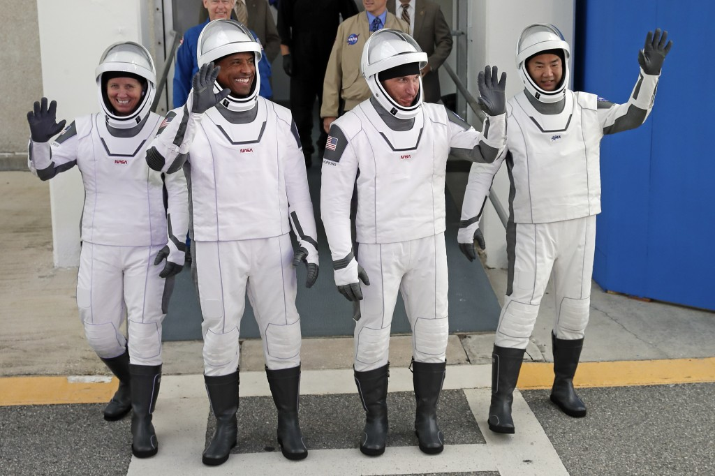 NASA astronauts, from left, Shannon Walker, Victor Glover, and Michael Hopkins and Japan Aerospace Exploration Agency astronaut Soichi Noguchi leave t...