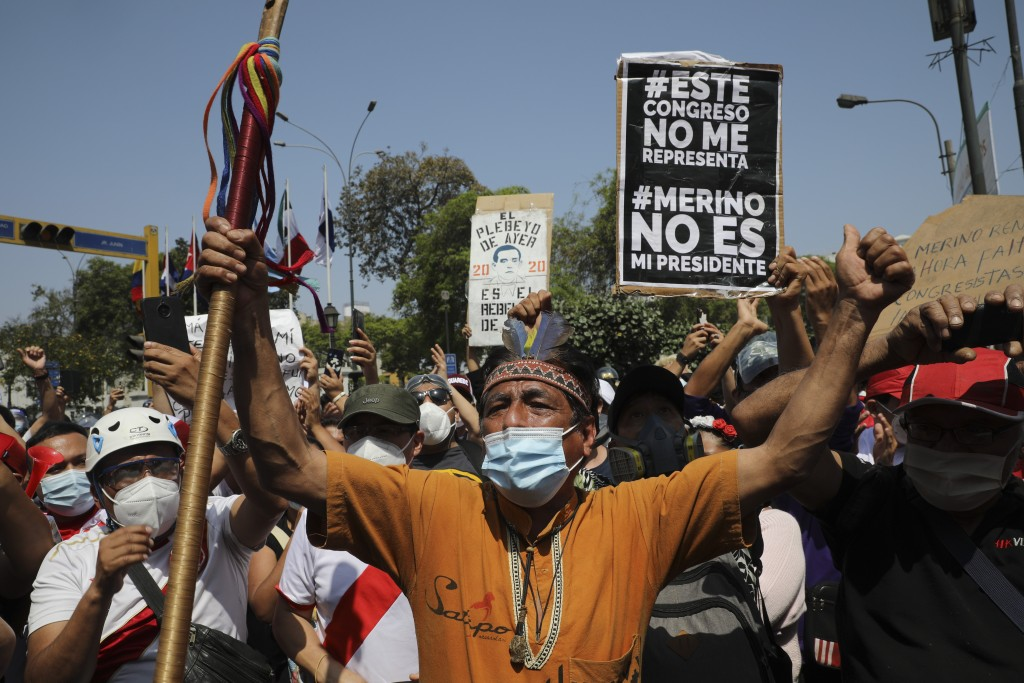 Protesters celebrate the resignation of interim president Manuel Merino in Lima, Peru, Sunday, Nov. 15, 2020. Merino stepped down Sunday after two peo...