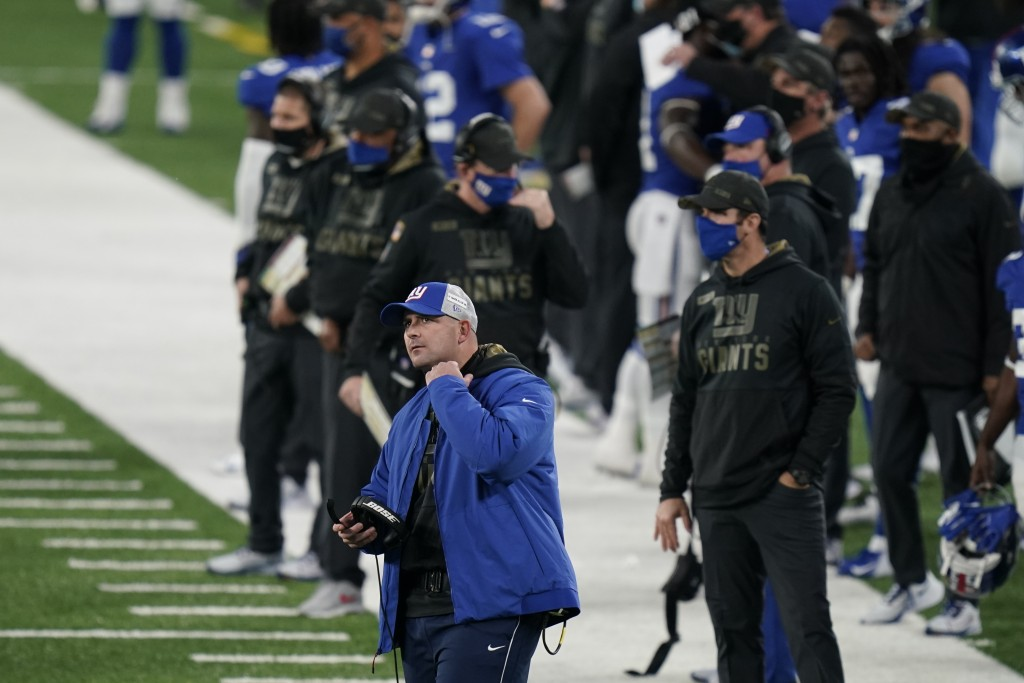 New York Giants head coach Joe Judge, front left, reacts during the second half of an NFL football game against the Philadelphia Eagles, Sunday, Nov. ...
