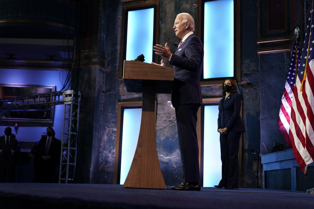 President-elect Joe Biden, accompanied by Vice President-elect Kamala Harris, speaks about economic recovery at The Queen theater, Monday, Nov. 16, 20...