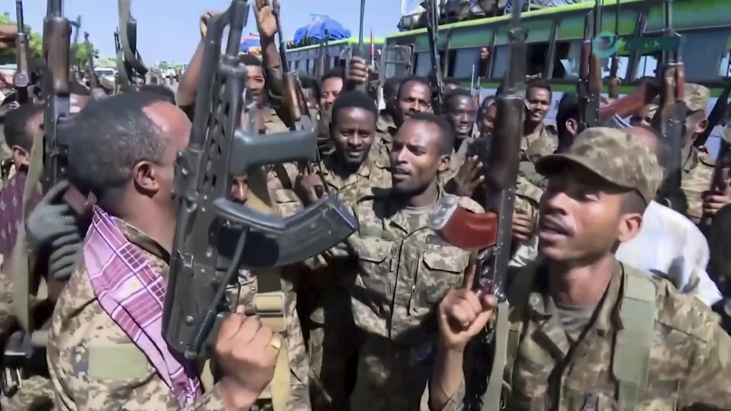 This image made from undated video released by the state-owned Ethiopian News Agency on Monday, Nov. 16, 2020 shows Ethiopian military cheering and da...