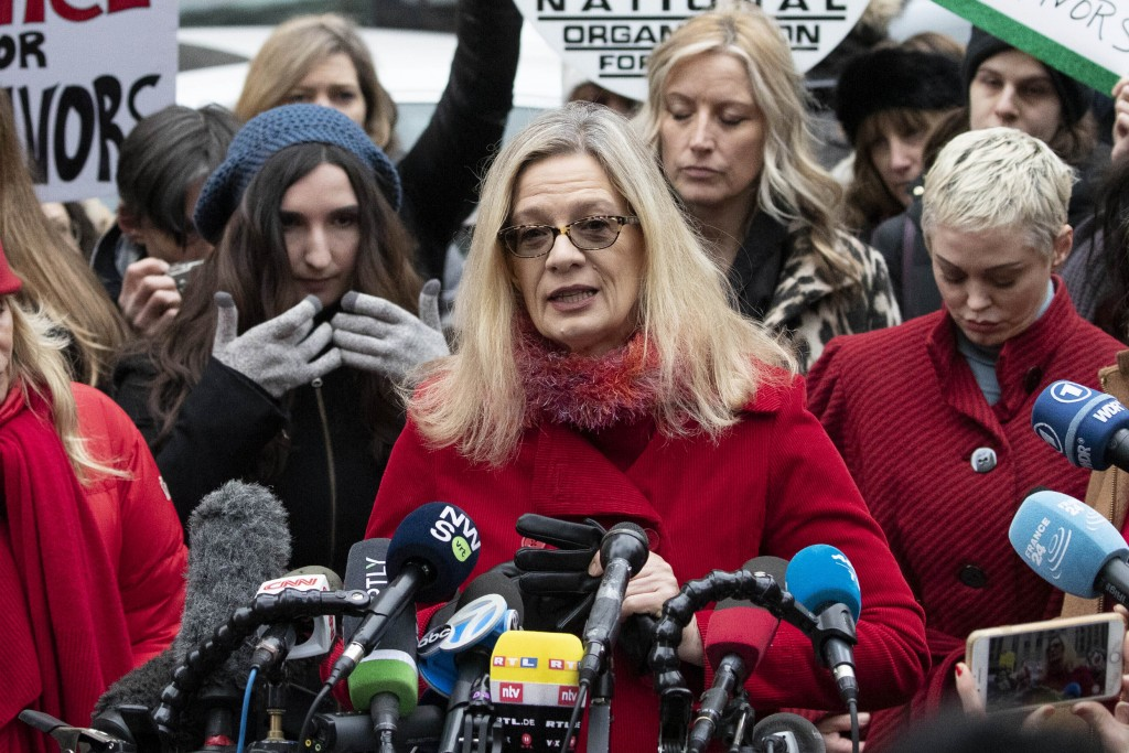 Actor Louise Godbold, center, speaks at a news conference outside a Manhattan courthouse after Harvey Weinstein arrived, Monday, Jan. 6, 2020, in New ...