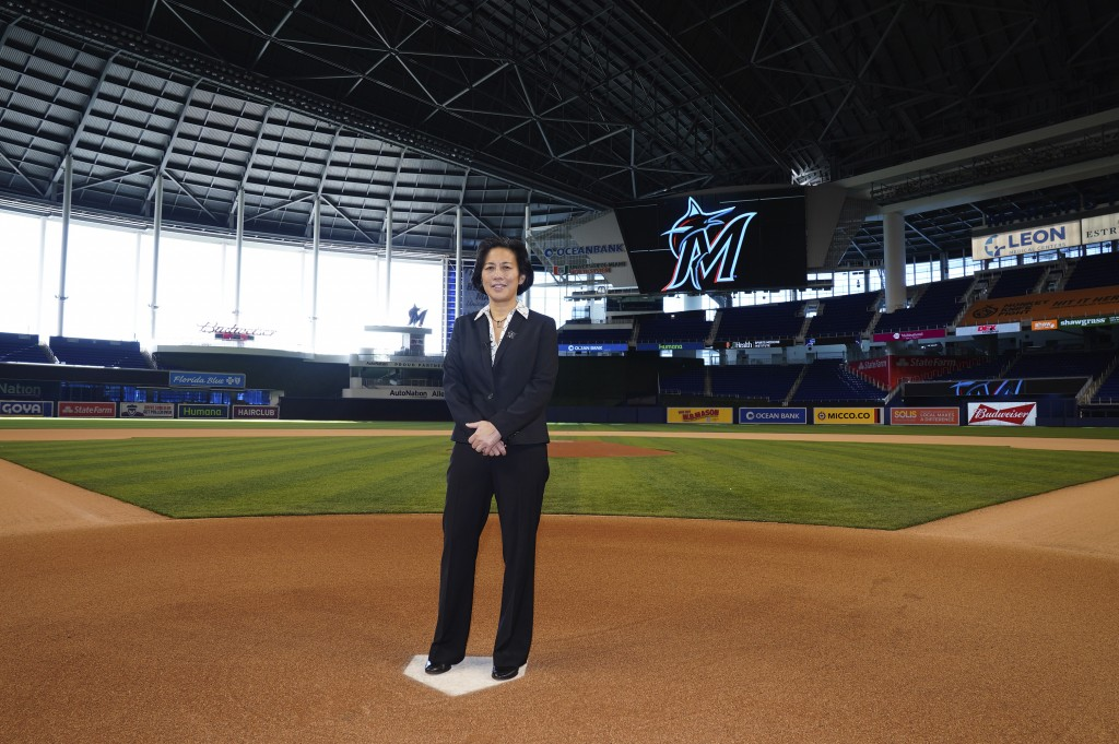 In this photo provided by the Miami Marlins, new Miami Marlins general manager Kim Ng poses for a photo at Marlins Park stadium before being introduce...