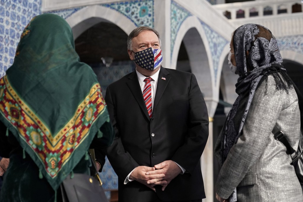 Secretary of State Mike Pompeo, centre, tours the Rustem Pasha Mosque in Istanbul, Tuesday, Nov. 17, 2020. Pompeo's stop in Turkey is focused on promo...