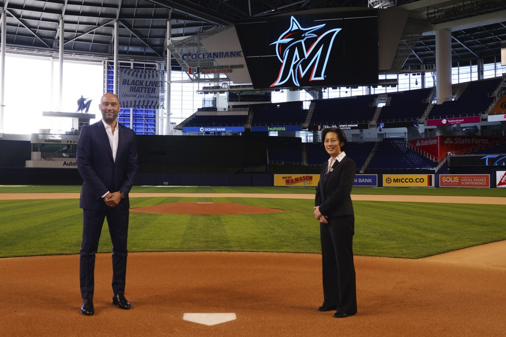 In this photo provided by the Miami Marlins, new Miami Marlins general manager Kim Ng, right, and CEO Derek Jeter pose for a photo at Marlins Park sta...
