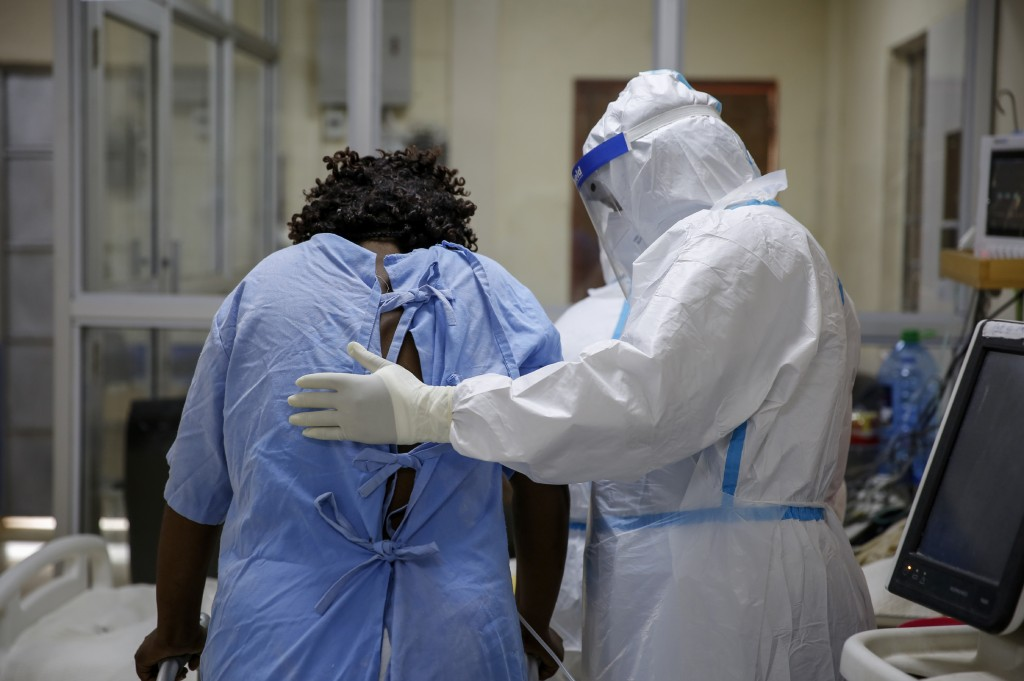 A medical worker attends to a coronavirus patient in the intensive care unit of an isolation and treatment center for those with COVID-19 in Machakos,...