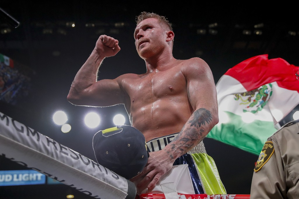 FILE - In this Saturday, Nov. 2, 2019 file photo, Canelo Alvarez celebrates after defeating Sergey Kovalev by knockout in a light heavyweight WBO titl...
