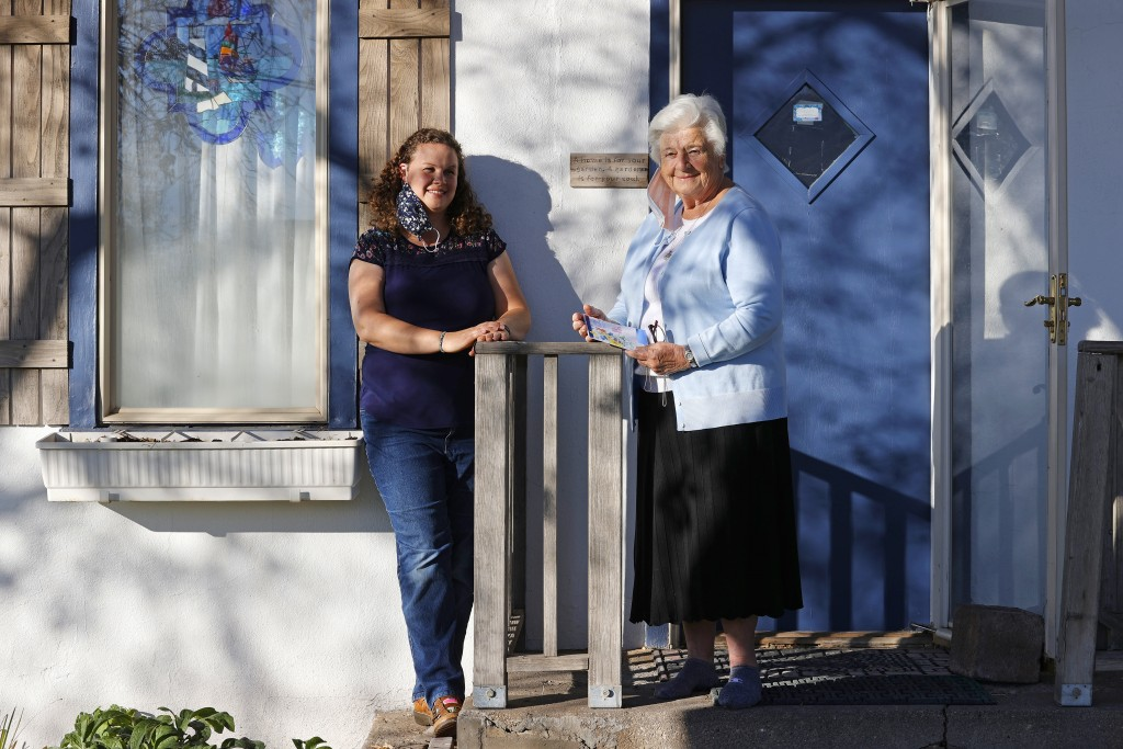 Amy Baird, left, and Marjan Martin Curtis pose at Curtis' home on Thursday, Nov. 12, 2020, in Spanish Fork, Utah. The pair formed a fast and unlikely ...