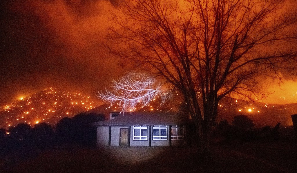 Embers from the Mountain View Fire burn along hillsides in the Walker community of Mono County, Calif., on Tuesday, Nov. 17, 2020. (AP Photo/Noah Berg...