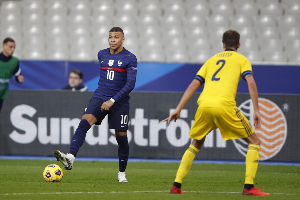 France's Kylian Mbappe controls the ball as Sweden's Mikael Lustig defends during the UEFA Nations League soccer match between France and Sweden at th...