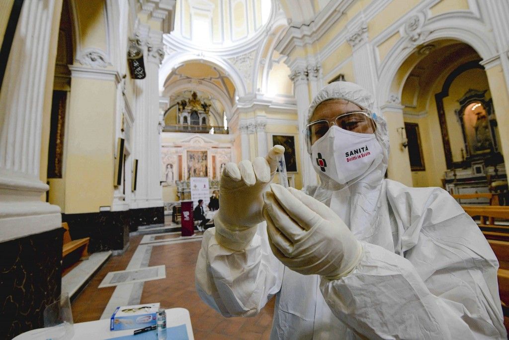 A medical operator prepares to perform COVID-19 test swabs in the Church of San Severo Outside the Walls, in the heart of Naples, Italy, Wednesday, No...