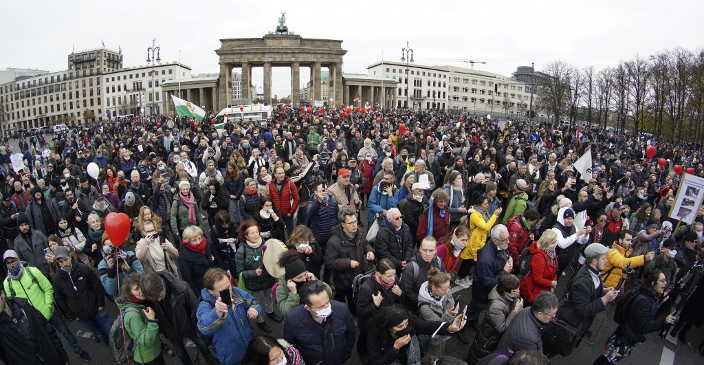 People attend a protest rally in front of the Brandenburg Gate in Berlin, Germany, Wednesday, Nov. 18, 2020 against the coronavirus restrictions in Ge...