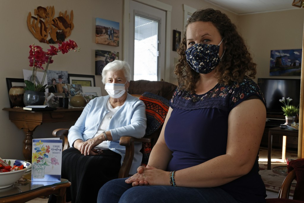 Marjan Martin Curtis, left and Amy Baird pose at Curtis' home on Thursday, Nov. 12, 2020, in Spanish Fork, Utah. Baird was driving on a familiar road ...