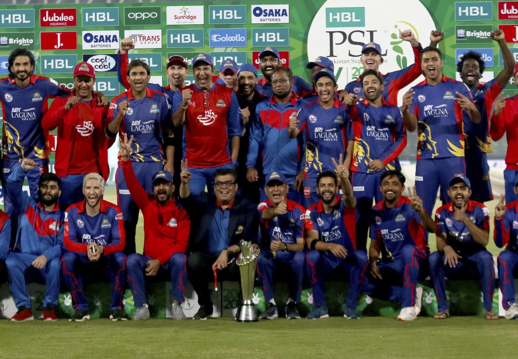 Karachi Kings officials and players pose with the winning trophy after the final of the Pakistan Super League T20 cricket match against Lahore Qalanda...