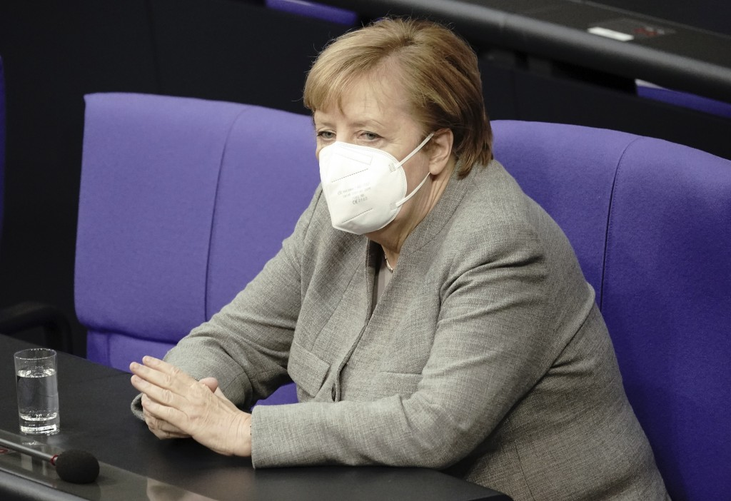 German Chancellor Angela Merkel attends a meeting of the German federal parliament, Bundestag, at the Reichstag building in Berlin, Germany, Wednesday...