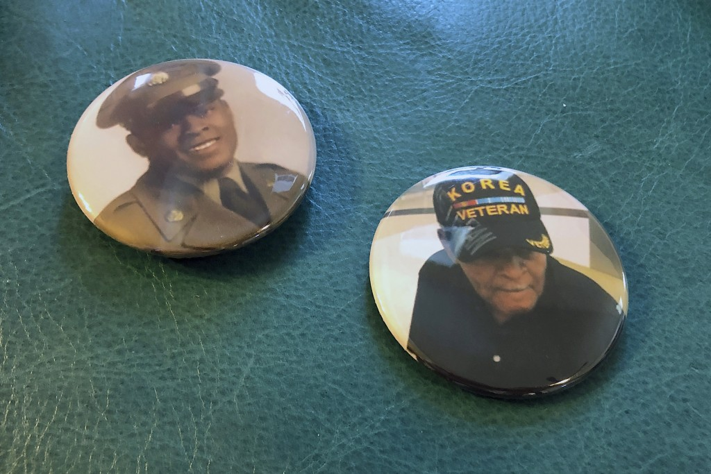 Two buttons handed out to mourners at Alex Leak Jr.'s graveside service sit on an ottoman in his daughter's home in Greensboro, N.C., on Wednesday, No...