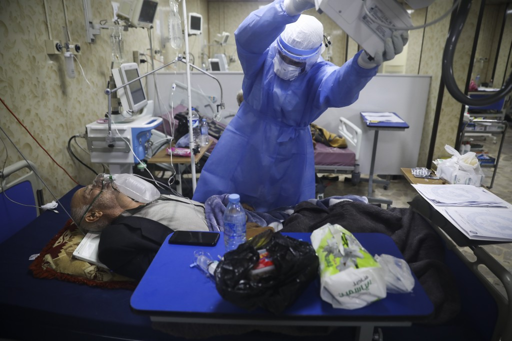 A medic works with corona patientsin a hospital in Idlib, Syria, Saturday, Nov. 14, 2020. At one of two coronavirus hospitals in Syria's rebel-held Id...