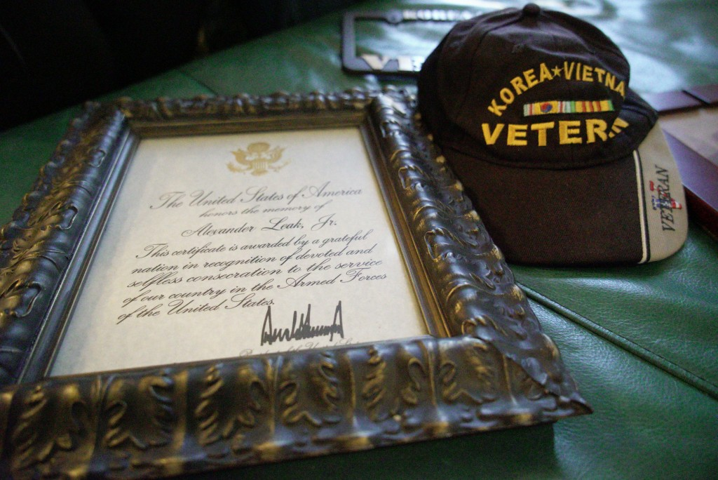 A veteran's condolence letter signed by President Donald Trump sits beside Alex Leak Jr.'s favorite cap at his daughter's home in Greensboro, N.C., on...