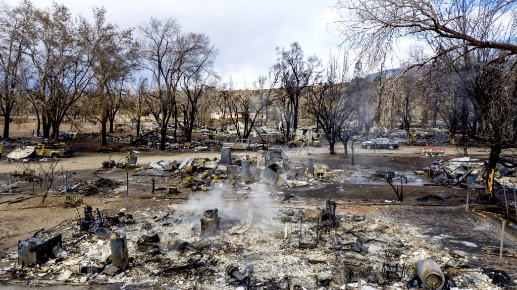 In this photo taken by a drone, residences leveled by the Mountain View Fire line a street in the Walker community in Mono County, Calif.,  Wednesday,...