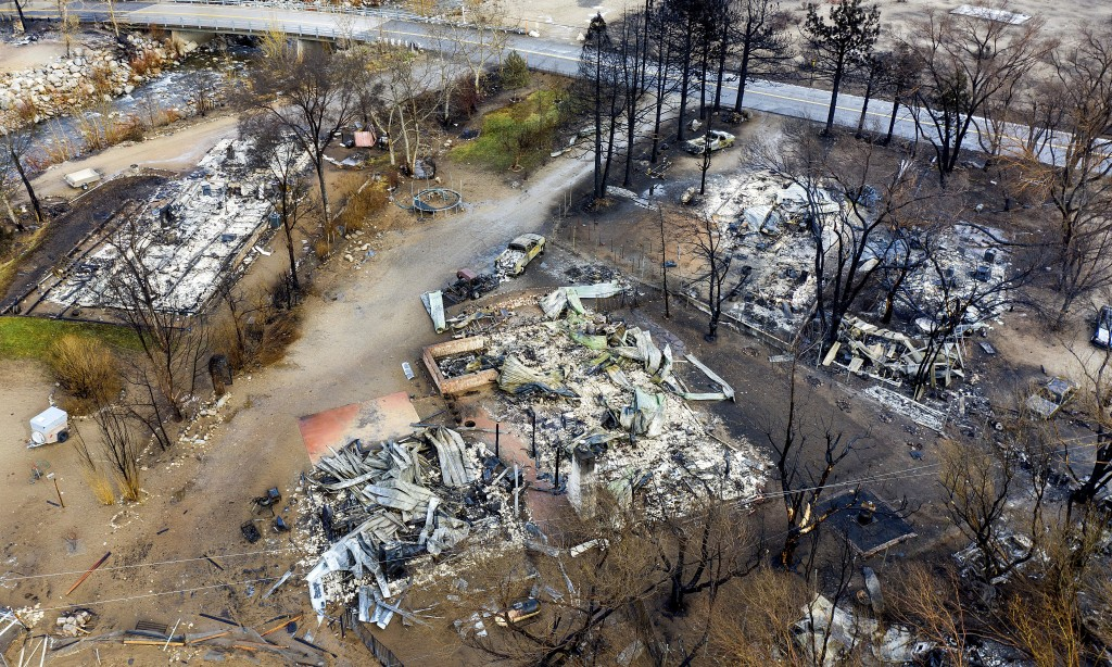 In this photo taken by a drone, homes destroyed by the Mountain View Fire line a street in the Walker community in Mono County, Calif., Wednesday, Nov...