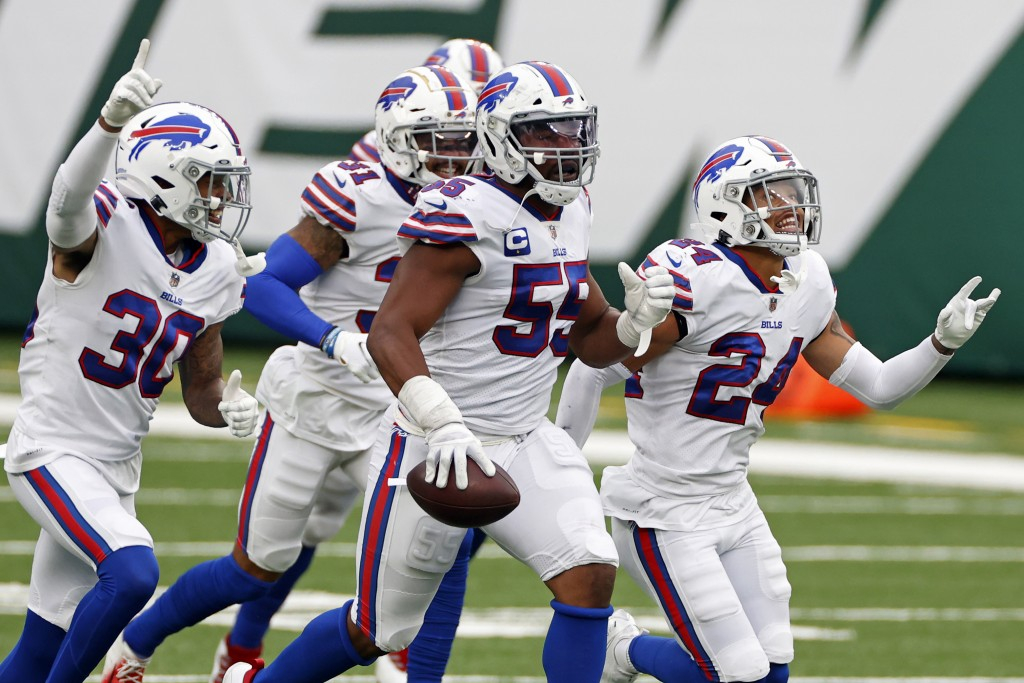 FILE - In this Oct. 25, 2020, file photo, Buffalo Bills defensive end Jerry Hughes (55) celebrates with teammates after an interception during an NFL ...
