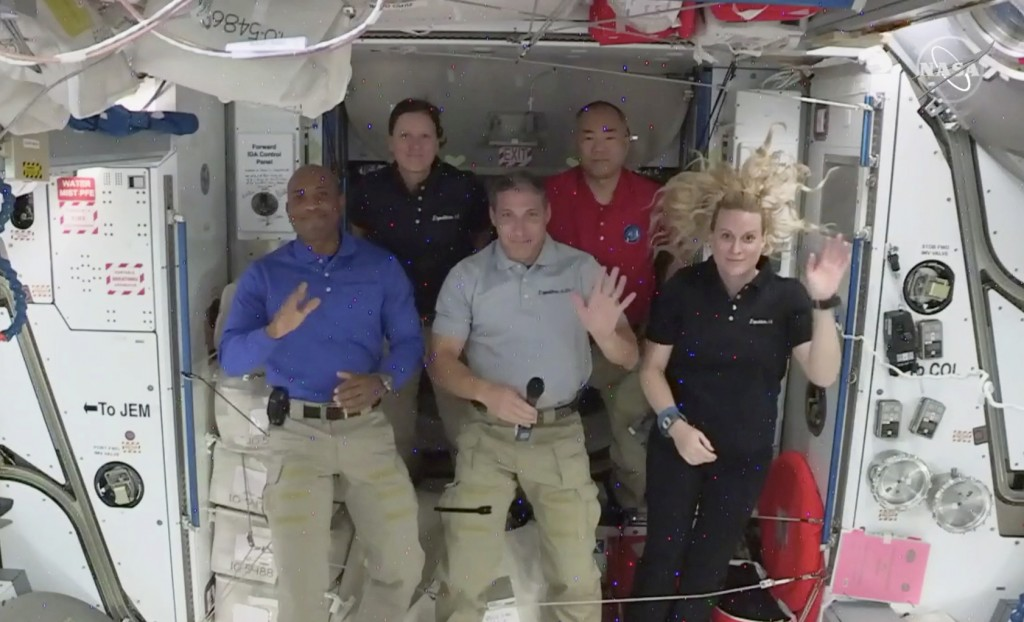 Crew -1 NASA astronauts from left to right pilot Victor Glover, mission specialist Shannon Walker, Crew Dragon commander Michael Hopkins,  Japan Aeros...