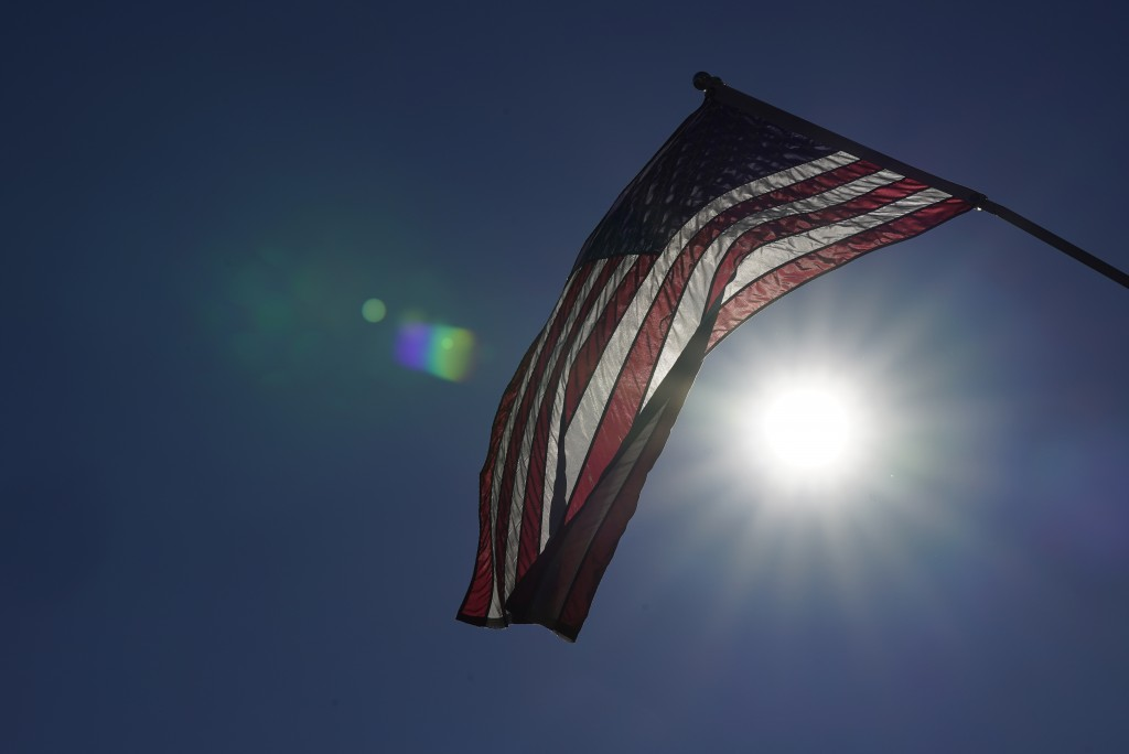 An American flag flies from a light pole, Wednesday, Nov. 11, 2020, in Terre Haute, Ind. Indiana's Vigo County had been America's more reliable presid...