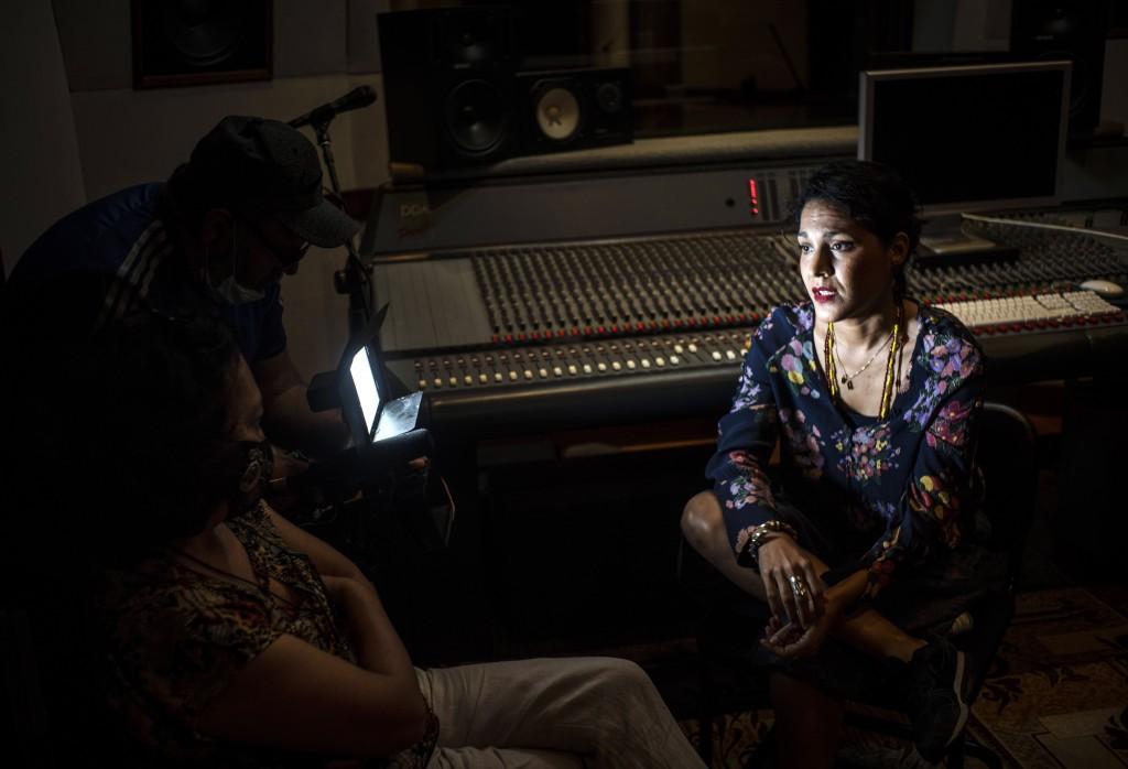 Cuban singer Haydee Milanes speaks during an interview amid the new coronavirus pandemic at a music studio in Havana, Cuba, Saturday, Nov. 14, 2019. T...