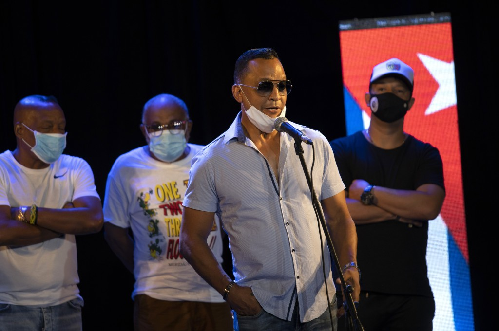 FILE - In this Sept. 18, 2020 file photo, Samuel Formell, leader of the Cuban orchestra Los Van Van, gives a press conference with fellow Cuban musici...