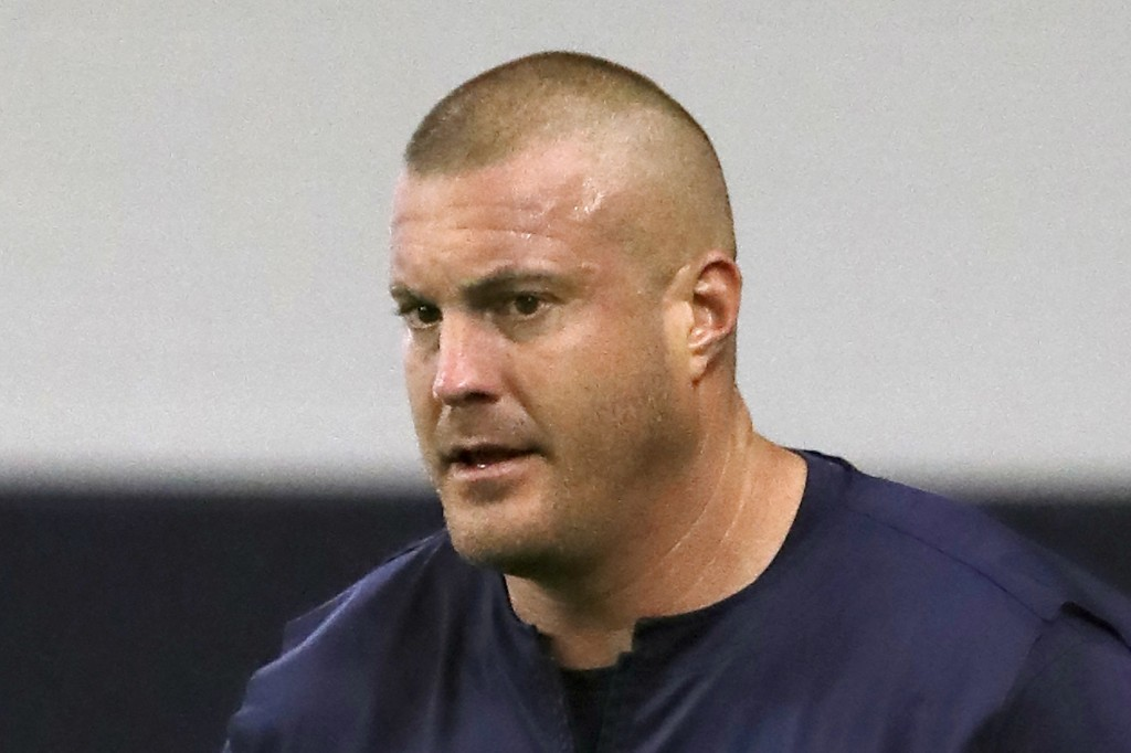 FILE - In this June 11, 2019, file photo, then-Dallas Cowboys offensive line coach Marc Colombo participates in drills at the team's NFL football trai...