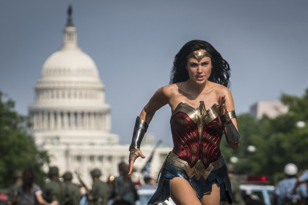 """This image released by Warner Bros. Pictures shows Gal Gadot as Wonder Woman in a scene from """"Wonder Woman 1984."""" The film isn't skipping theaters or ..."""