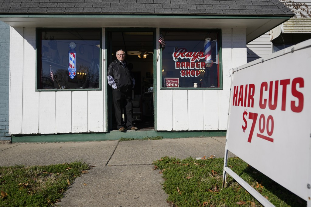 Ray Nicoson stands at the entrance of his barber shop, Wednesday, Nov. 11, 2020, in Terre Haute, Ind. Indiana's Vigo County had been America's more re...