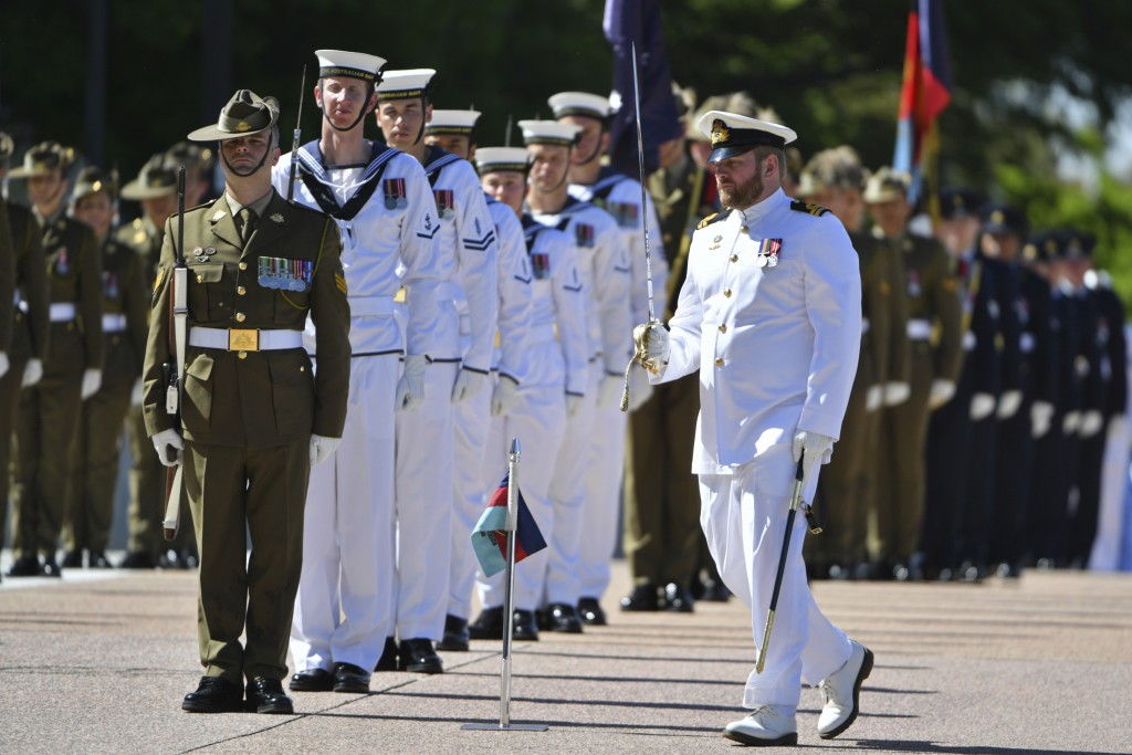 An honor guard is formed at Defence Headquarters in Canberra, Australia, Thursday, Nov. 19, 2020, before findings from the Inspector-General of the Au...