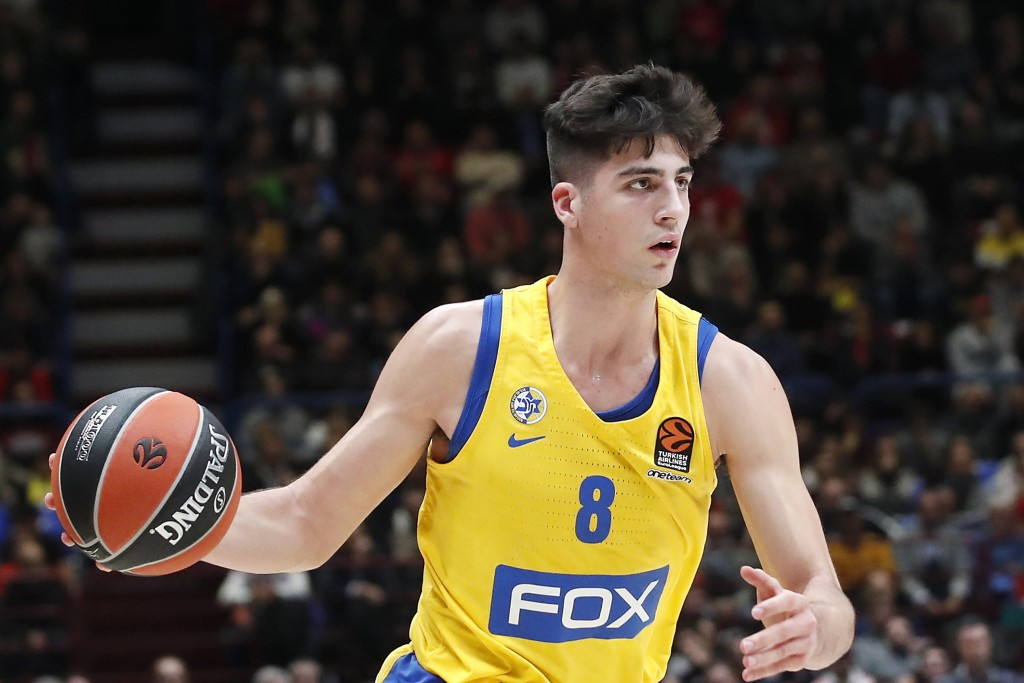 FILE - In this Nov. 19, 2019, file photo, Maccabi Fox Tel Aviv's Deni Avdija controls the ball during the Euro League basketball match between Olimpia...