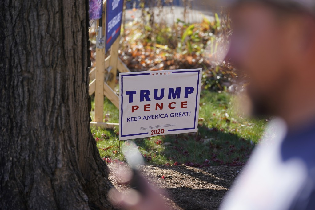 A President Donald Trump sign is posted in the front yard of Craig Rudisel as he speaks about Vigo County voting, Wednesday, Nov. 11, 2020, in Terre H...