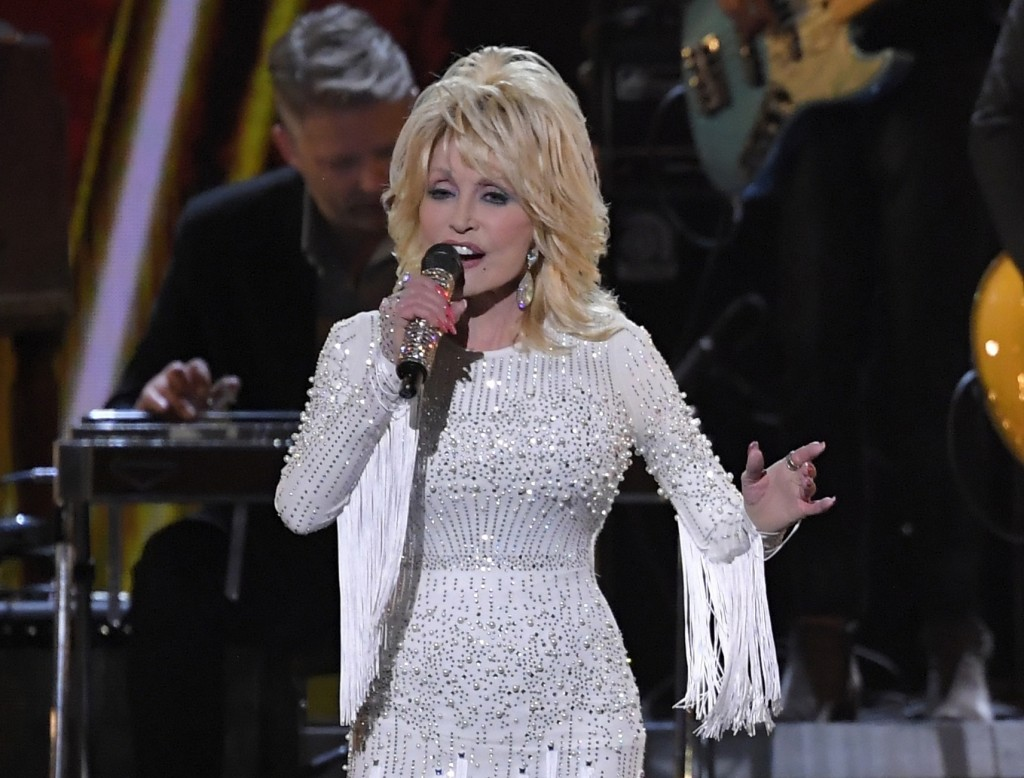 FILE - In this Nov. 13, 2019 file photo, Dolly Parton performs at the 53rd annual CMA Awards in Nashville, Tenn. Parton's $1 million gift to Nashville...