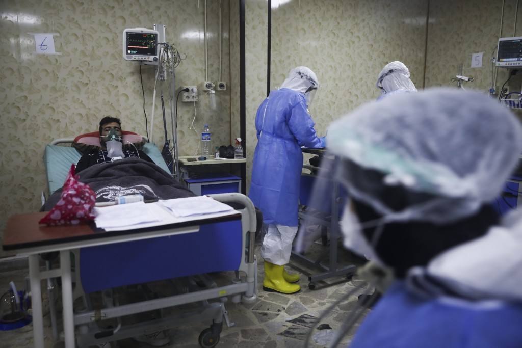 Medics work with corona patients in a hospital in Idlib, Syria, Saturday, Nov. 14, 2020. At one of two coronavirus hospitals in Syria's rebel-held Idl...