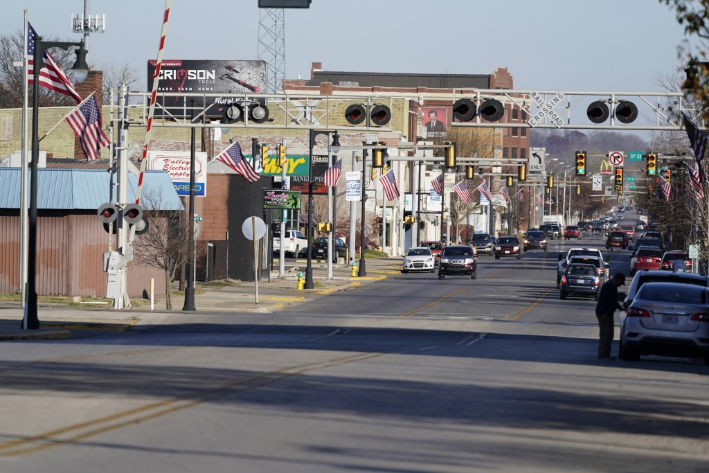 American flags fly from light poles, Wednesday, Nov. 11, 2020, in Terre Haute, Ind. Indiana's Vigo County had been America's more reliable presidentia...